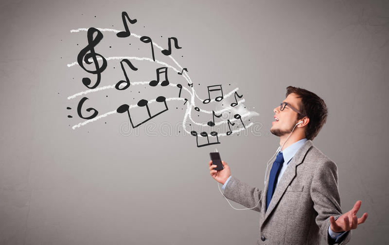 Boy Singing And Listening To Music Stock Photography