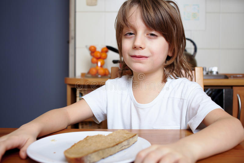 Download Boy Sits At Kitchen Table And Doesn't Want To Eat Stock Photo - Image of face, dieting: 23186256