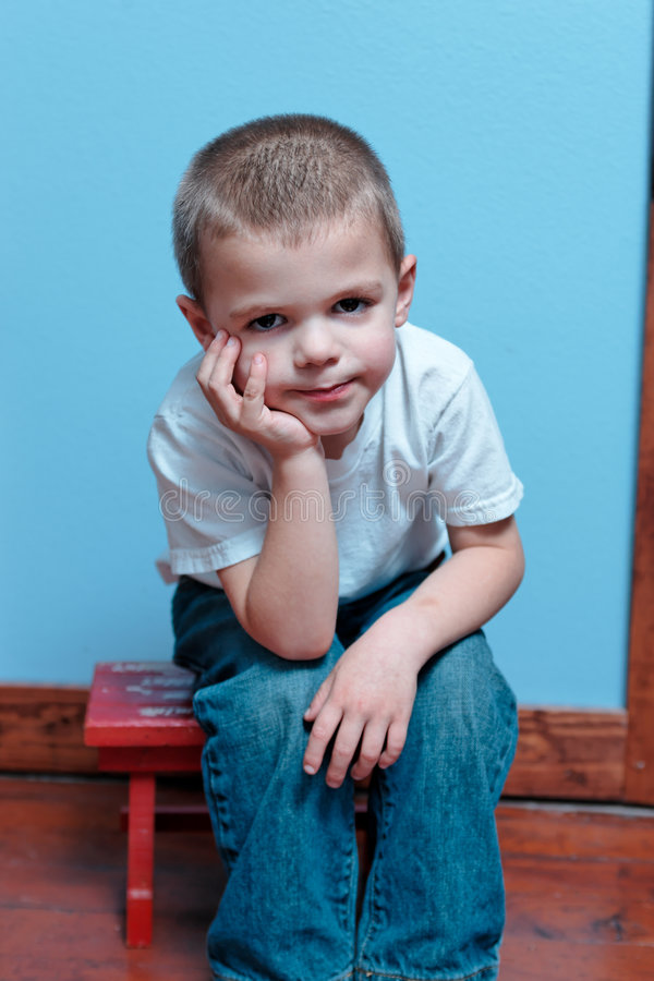Download Boy sitting stock photo. Image of stop, shirt, quit, upset - 2623014