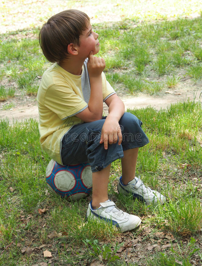 Download A Boy Sitting On The Ball Royalty Free Stock Photos - Image: 25198588