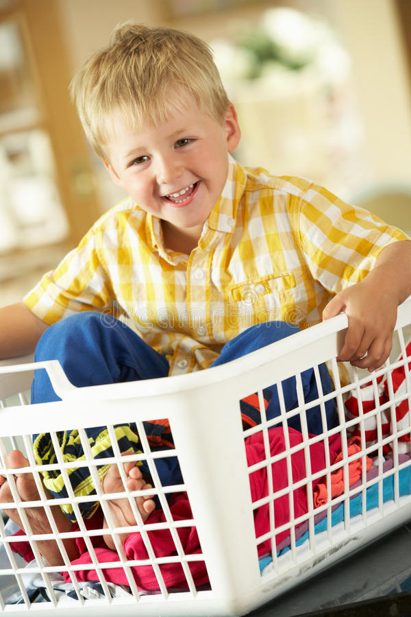 Download Boy Sitting In Basket Sorting Laundry Stock Photo - Image: 27704396
