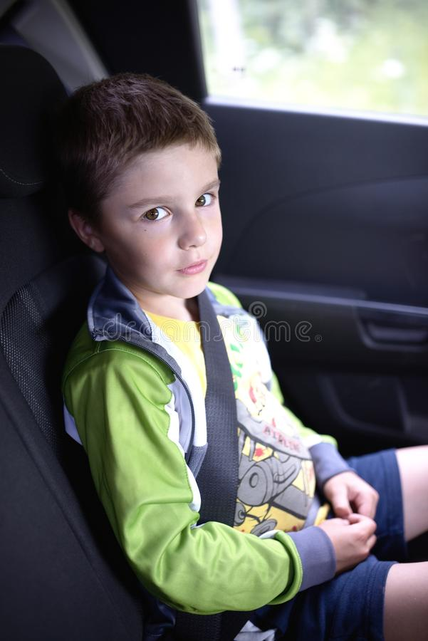 Boy sitting in car safety chair royalty free stock photography