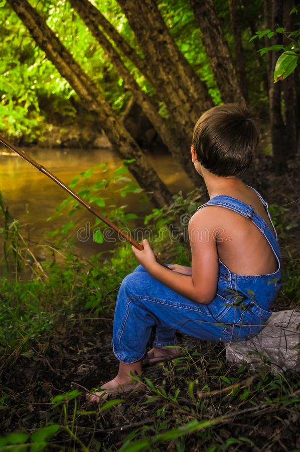 A Boy Fishing royalty free stock photos