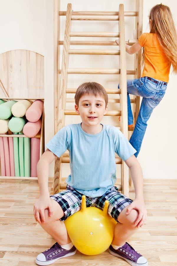 Boy sitting on gymnastic ball