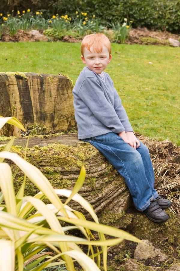 Boy Sitting Outside Royalty Free Stock Photography