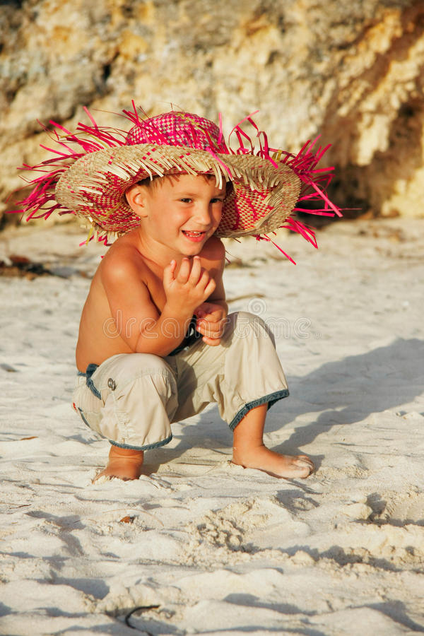Download Boy sitting on sand beach stock image. Image of sand - 12960933