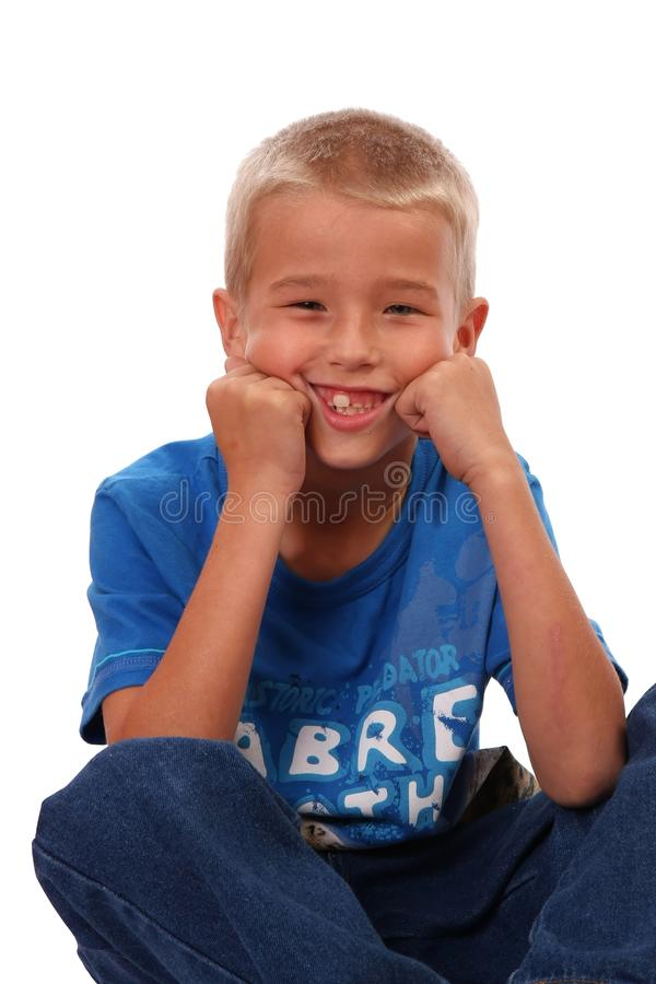 Boy Sitting and Smiling royalty free stock photo