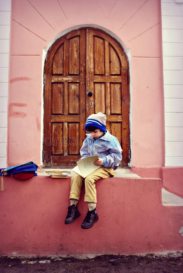 Boy Sitting On Stairs Holding Book Free Public Domain Cc0 Image