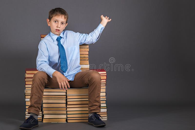 Boy sitting on a throne from books royalty free stock photo