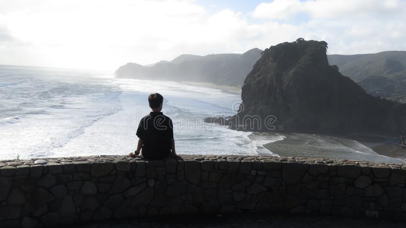 Boy Sitting on the Wall royalty free stock image