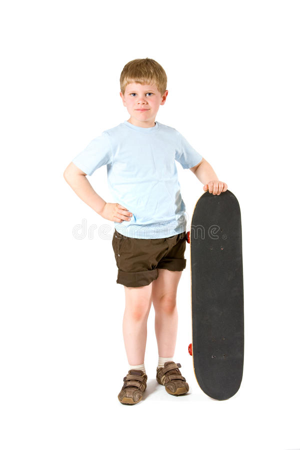 Boy with skateboard. Studio shot of little boy with skateboard. Isolated on white background stock photography