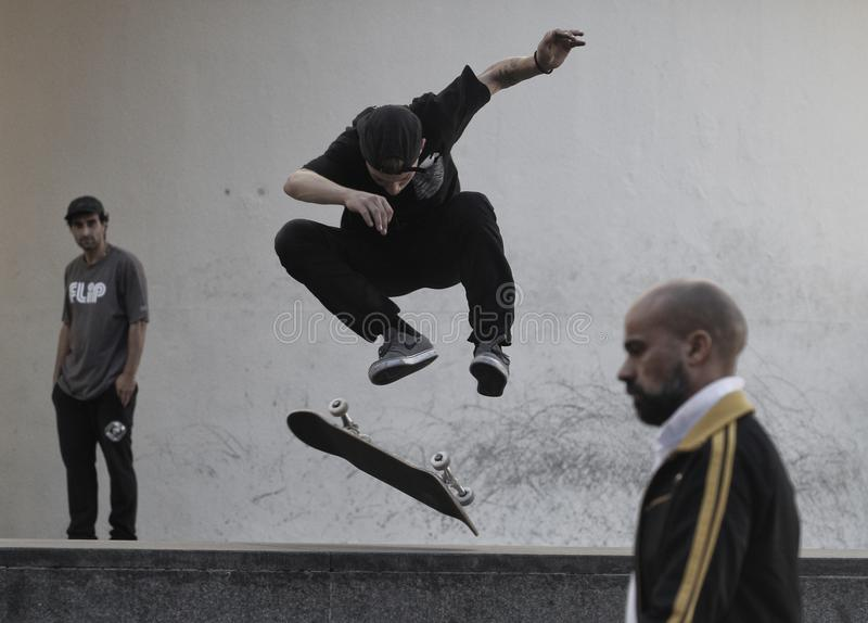 Skater trains in Barcelona. Boy skateboarding in Barcelona in front of the Museum of Contemporary Art of the city. Barcelona is chosen today by many skaters from