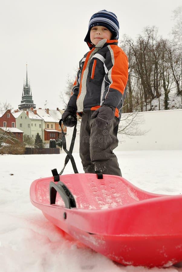 Boy with sled stock photos