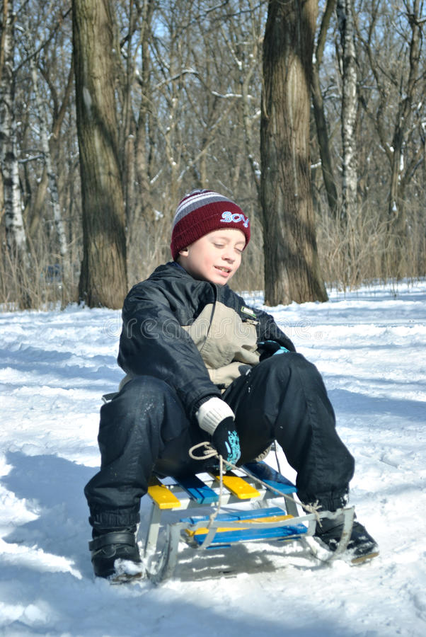 The Boy With Sled Stock Images