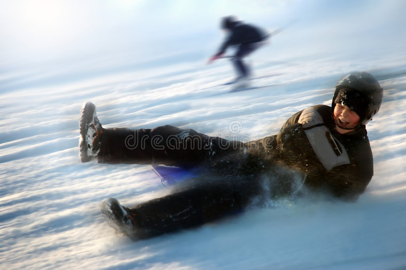 Boy on sled stock photos
