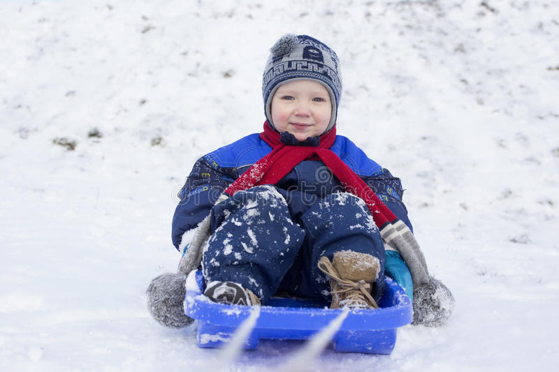Boy and sled stock image