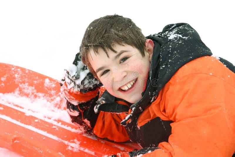 Boy Sledding stock photo