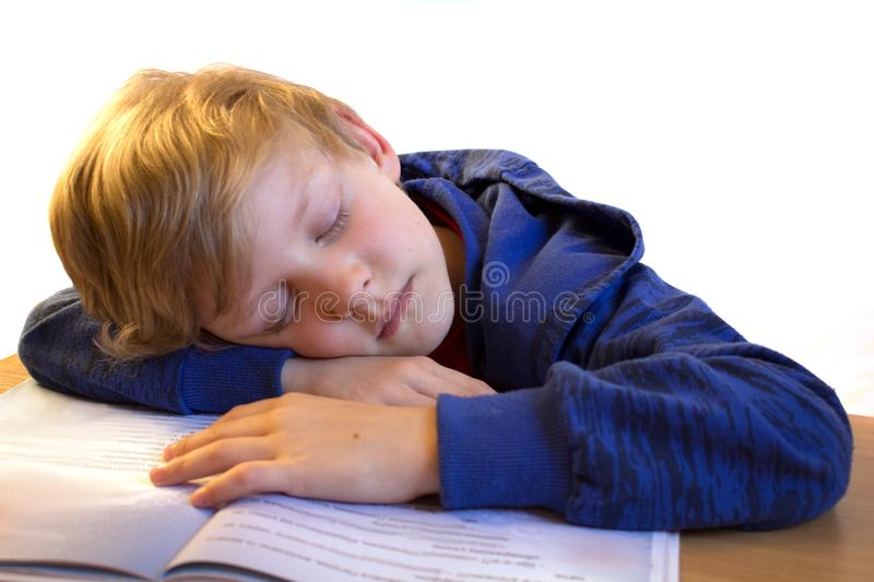 Boy sleep on the book royalty free stock photo