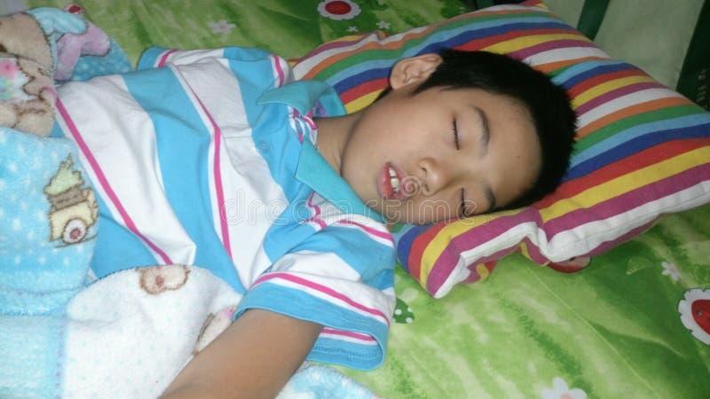 Boy sleeping royalty free stock photography