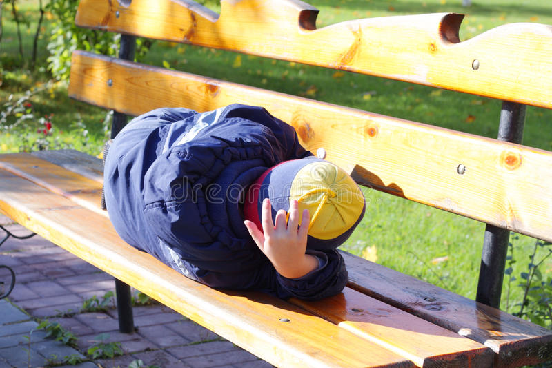 Download Boy sleeping on bench stock photo. Image of male, blue - 11182538
