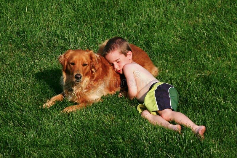 Download Boy Sleeping On Dog Stock Photography - Image: 1212142