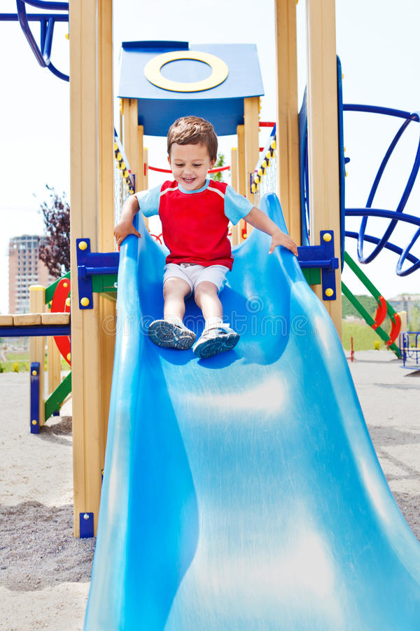 Download Boy on a slide stock image. Image of smiling, laughing - 23820127