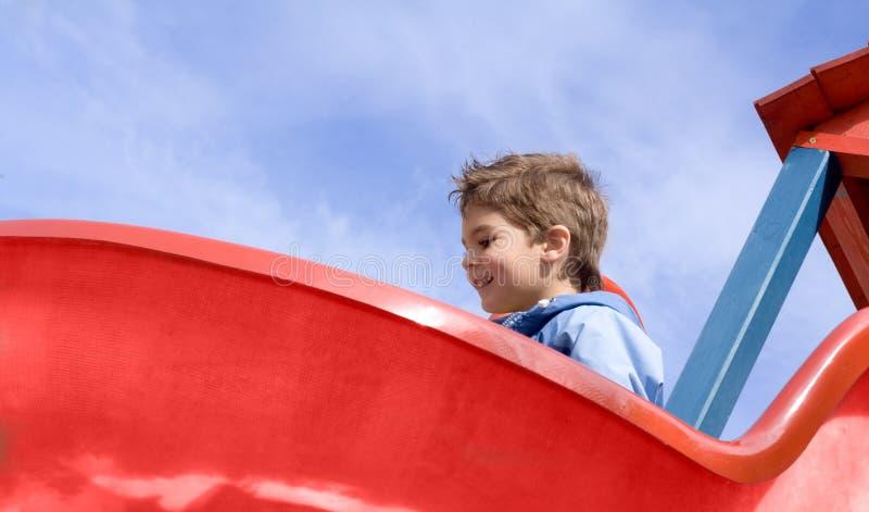 Download Boy on the slide stock image. Image of slide, joyful, smiling - 2413499