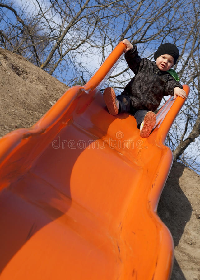 Boy on a slide stock image