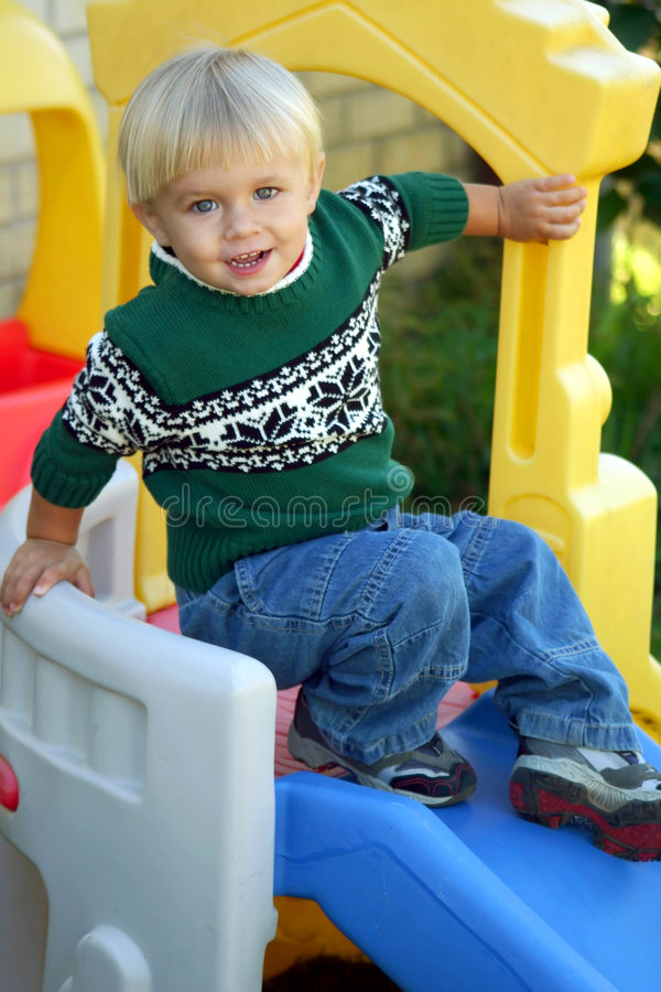 Boy on slide royalty free stock photography