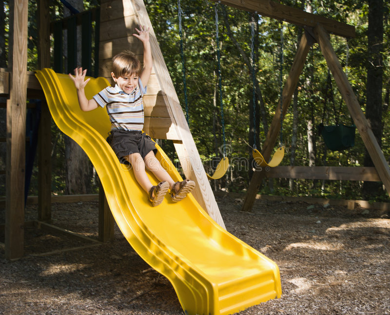 Boy on slide. royalty free stock photography