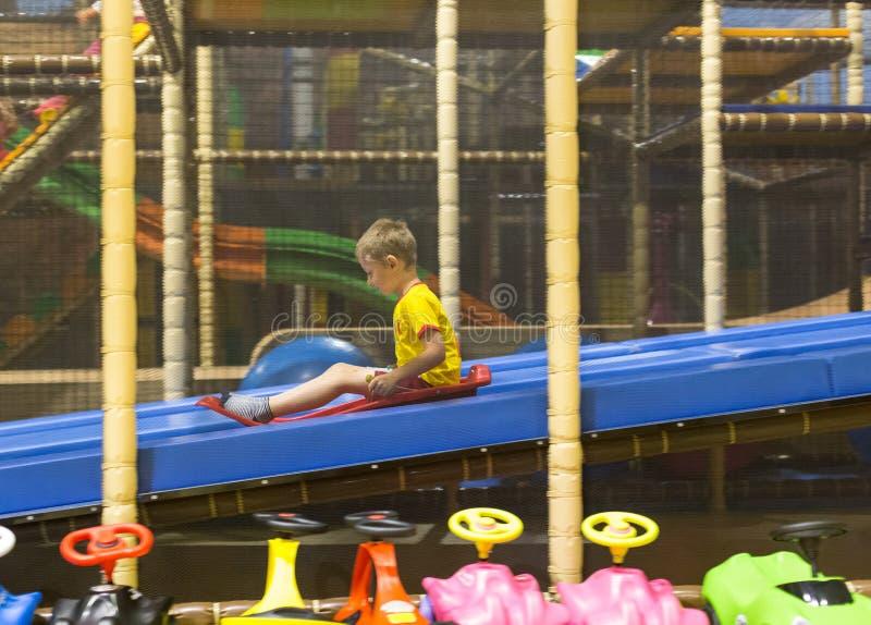 Download Boy sliding on playground stock photo. Image of sport - 106419042