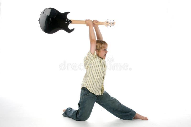 Boy smashing guitar