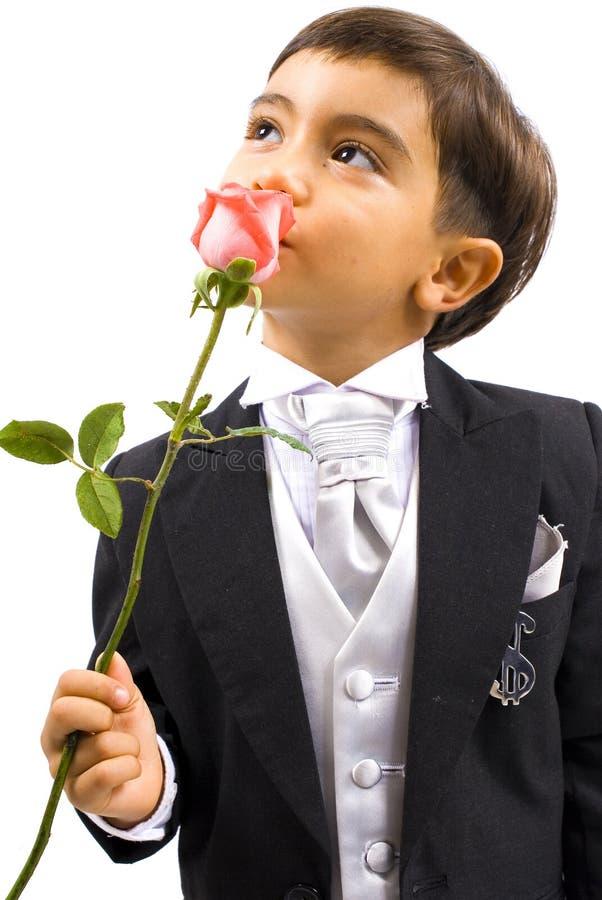 Boy smelling royalty free stock photo