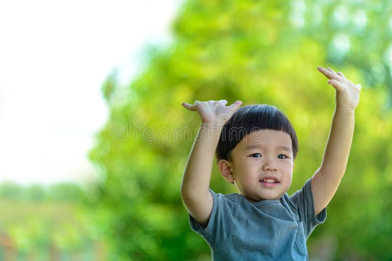 The boy smiled while looking at the camera stock images