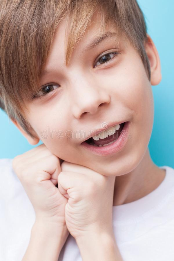 Boy smiles and is touched stock photos