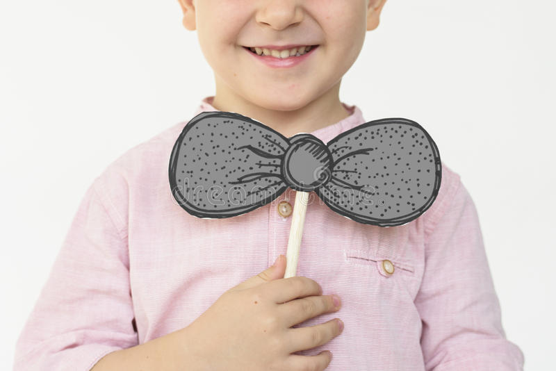 A boy smiling with bow tie stock photo