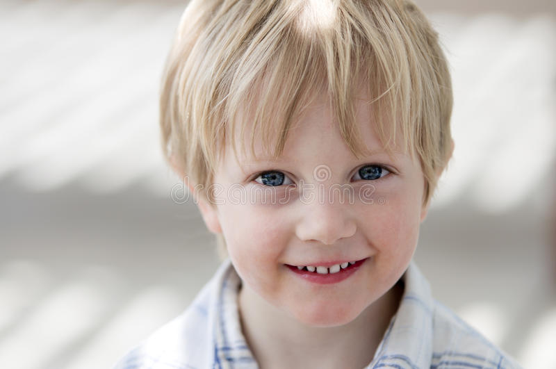 Boy smiling at viewer royalty free stock images