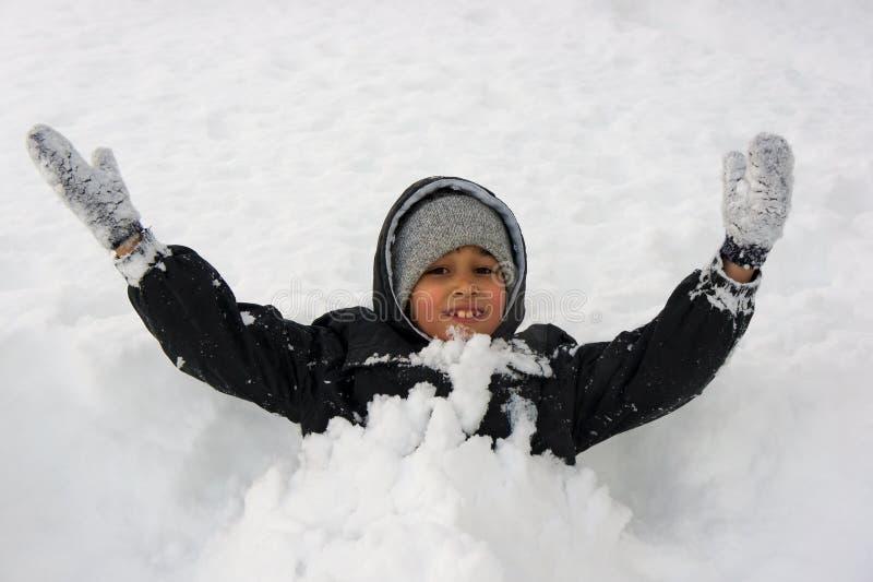 Boy in snow stock photo