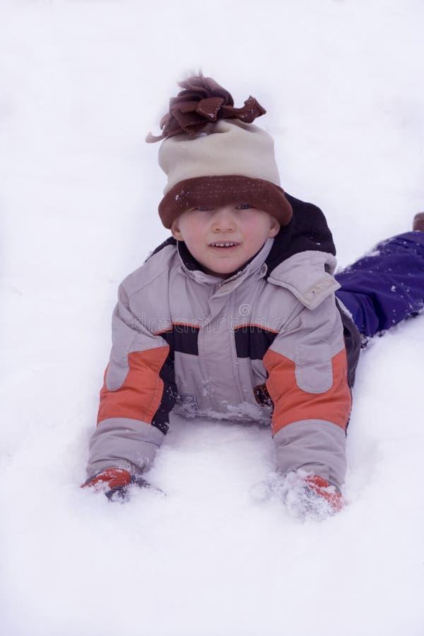 Boy on snow royalty free stock photos