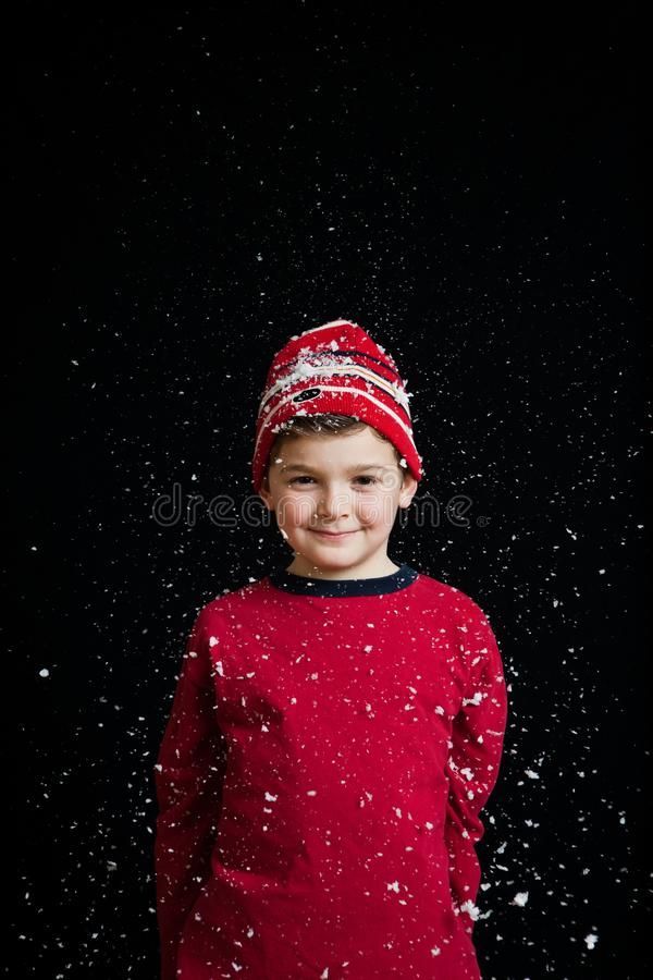 Boy with snow backdrop royalty free stock image