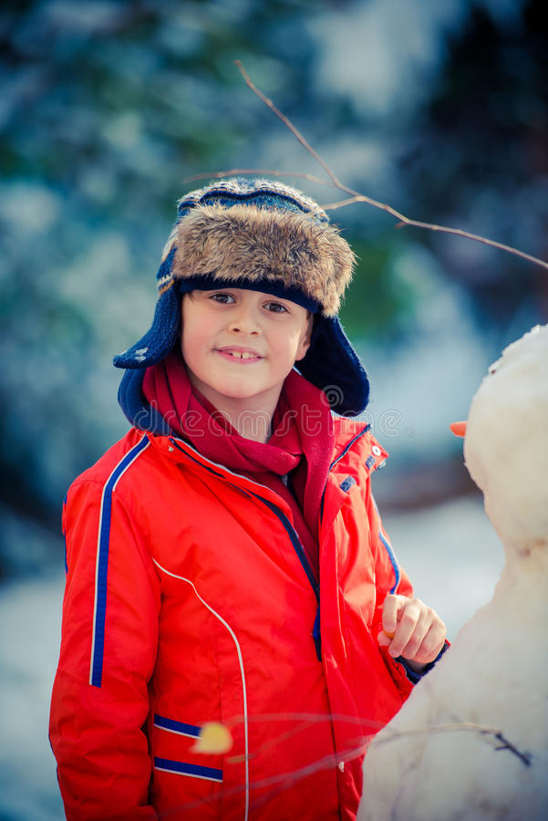 Boy on a snow. royalty free stock photography