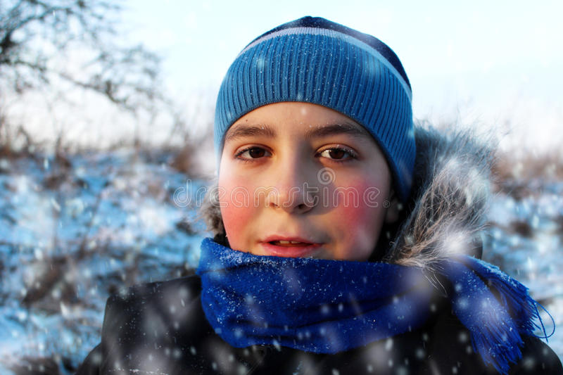 Boy in the snow. stock photo