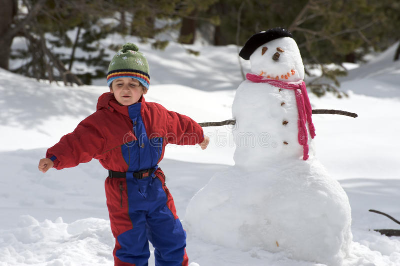Download Boy with snowman stock image. Image of winter, tree, snowman - 13948807