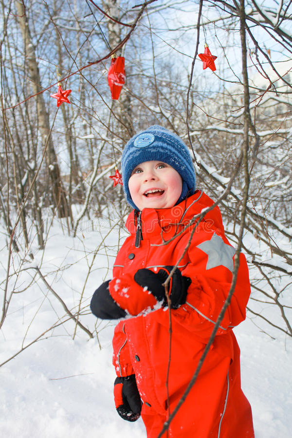 Boy in the snowy forest. Boy having fun in the winter forest stock photos