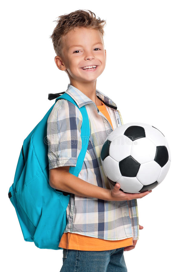 Boy with soccer ball. Happy schoolboy with backpack and soccer ball isolated on white background stock photo