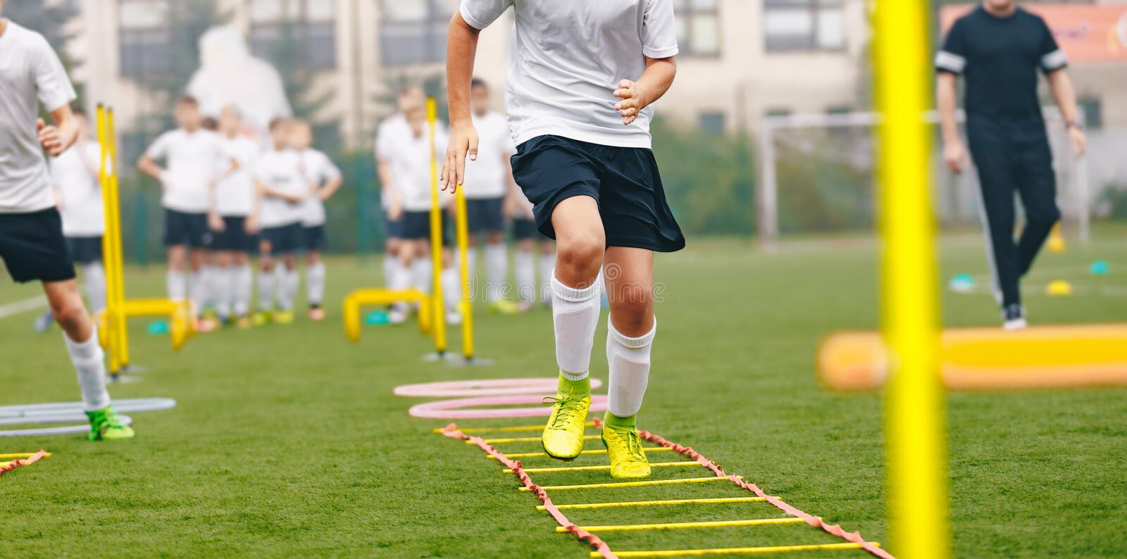 Boy Soccer Player In Training. Young Soccer Players at Practice Session. Boys Running Youth Agility Ladder Drills. Soccer Ladder Exercises stock images