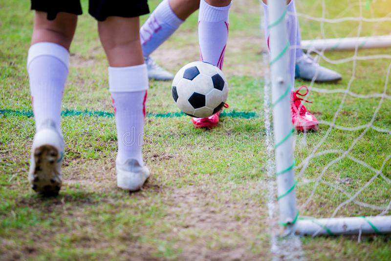 Boy soccer players trap and control the ball for shoot at front stock photography