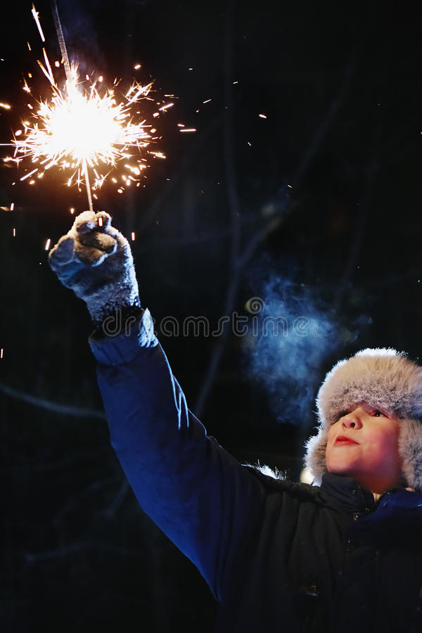 Download Boy With Sparkler Royalty Free Stock Image - Image: 22813366