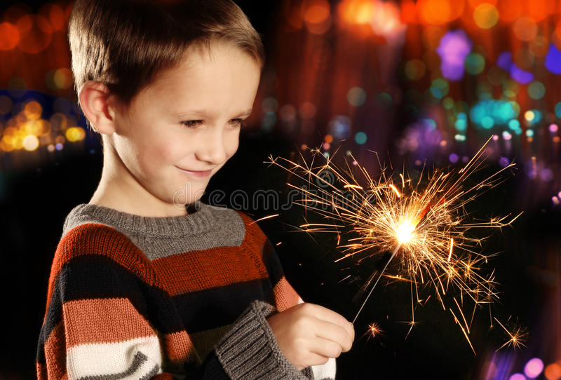 Boy with sparkler stock image