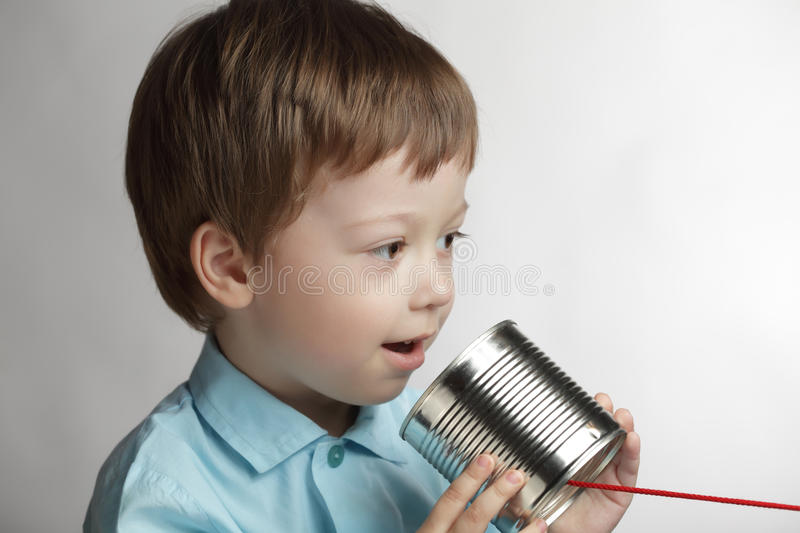 Download Boy Speak In Tin Can Telephone Stock Photo - Image: 24723780